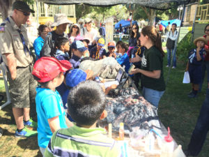 Hannah Dietterich talks to kids at the San Jose area Scout-o-Rama in 2015